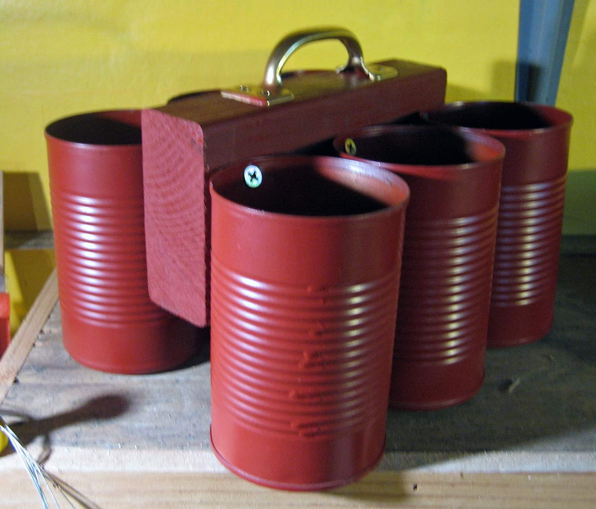 Homemade Tool Caddy of soup cans, handle and wood