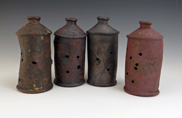 ceramic shot-up rusty conetop beer cans