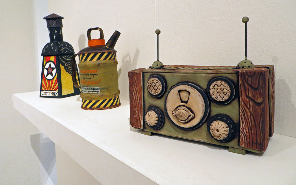 Three ceramic sculptures of incinerator, gas can and communication device