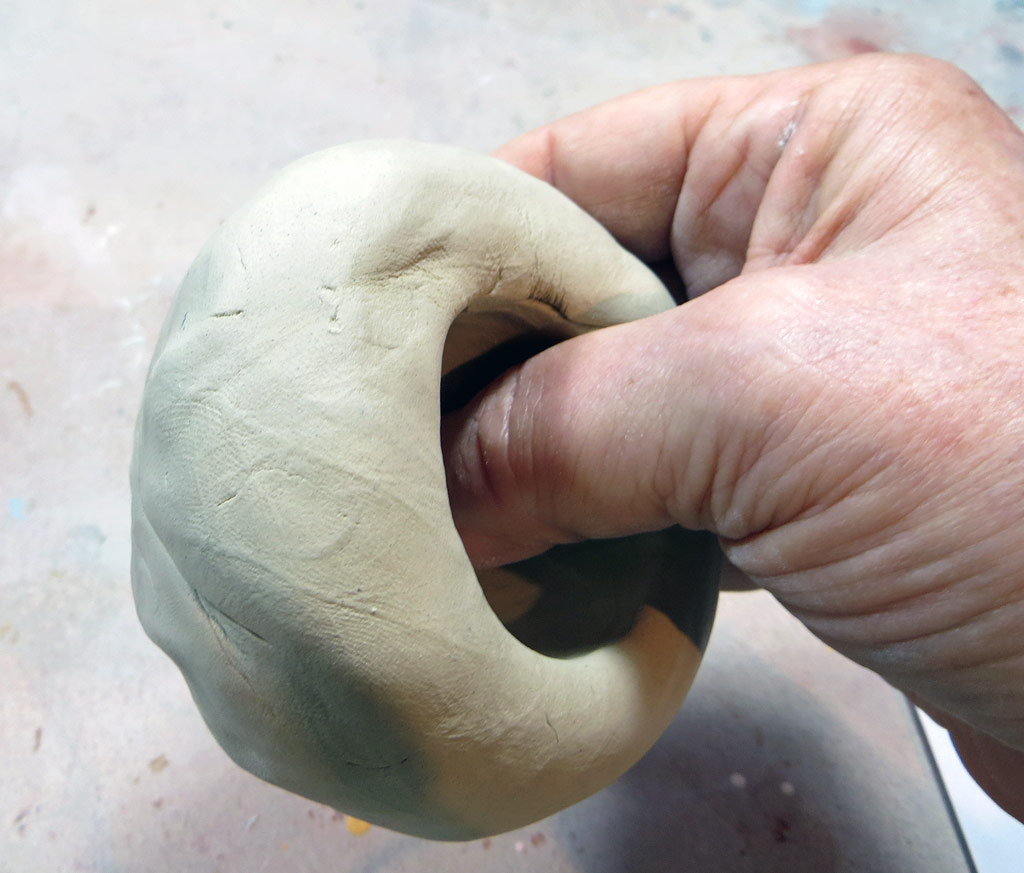 Opening a ball of clay for a pinch pot