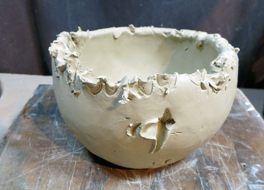All pecked leatherhard clay bowl
