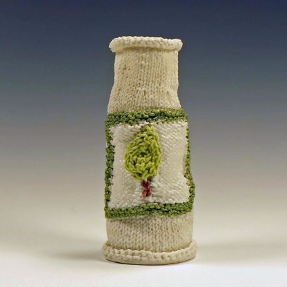 knitted porcelain vase with colored label